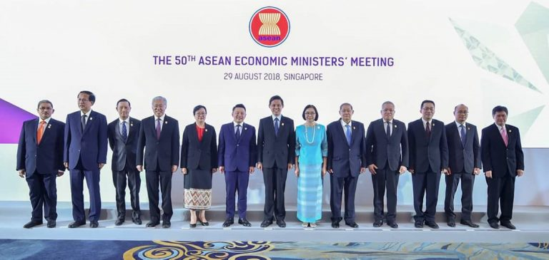 Union Minister for Planning and Finance U Soe Win and officials pose for a documentary photo at the 50th ASEAN Economic Ministers' Meeting at Shangri-La Hotel in Singapore yesterday. Photo: MNA