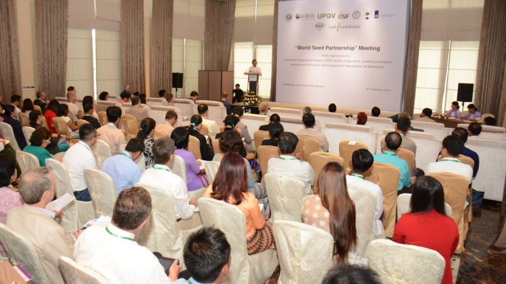 """Union Minister Dr. Aung Thu addresses the """"World Seed Partnership meeting"""" in Nay Pyi Taw yesterday.  Photo: MNA"""