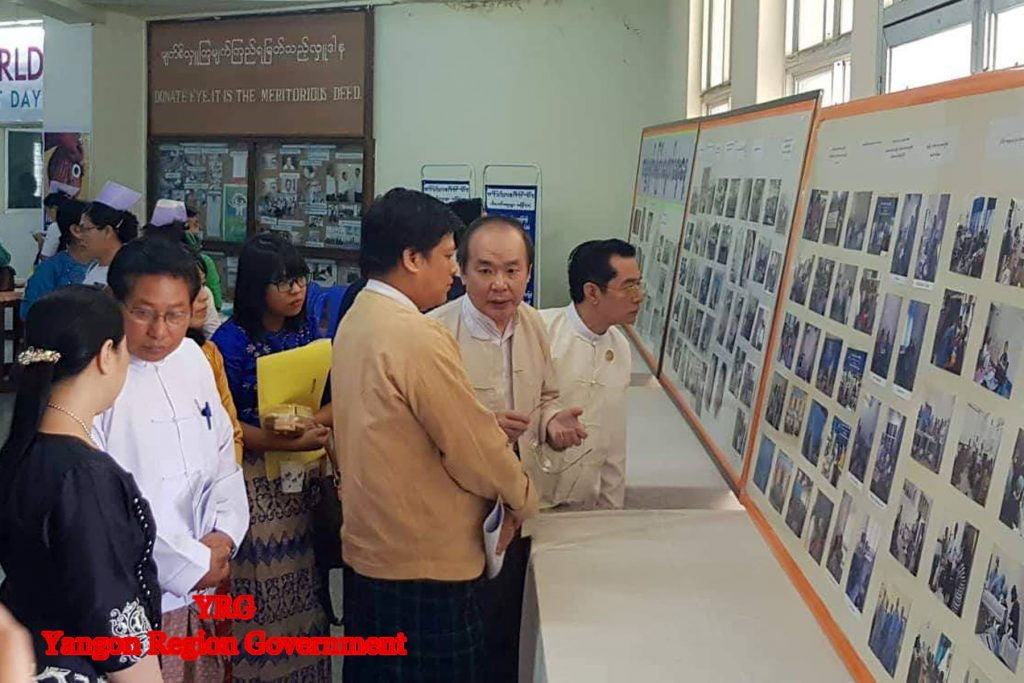 Yangon Region Minister for Social Affairs U Naing Ngan Lynn looks at documentary photos displayed at the celebration event of the World Sight Day held on 11 October at the Yangon Eye Hospital. Photo: Yangon Region Government