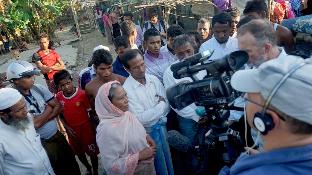 Journalists interview local people at Thet Kel Pyin Camp in Sittway yesterday.photo: aung ye thwin