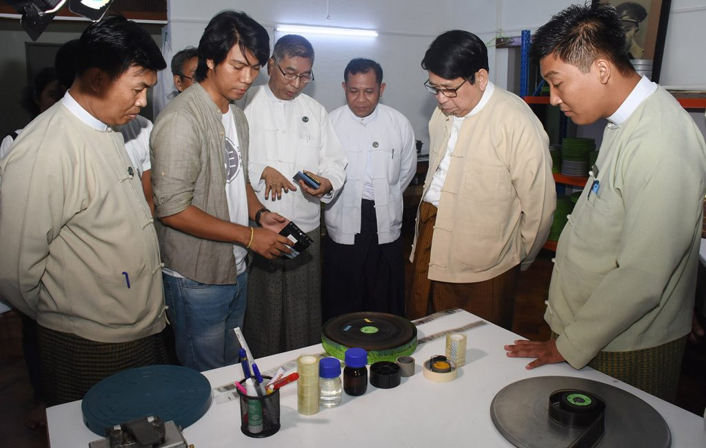 Union Minister Dr Pe Myint and officials observing the preservation of movies and related paraphernalia at the film preservation centre.  Photo: MNA