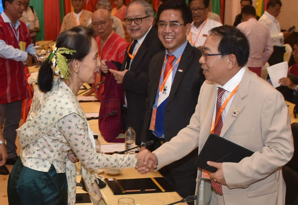 State Counsellor Daw Aung San Suu Kyi greets U Yawd Serk, Chairman of the Restoration Council of Shan State/ Shan State Army.
