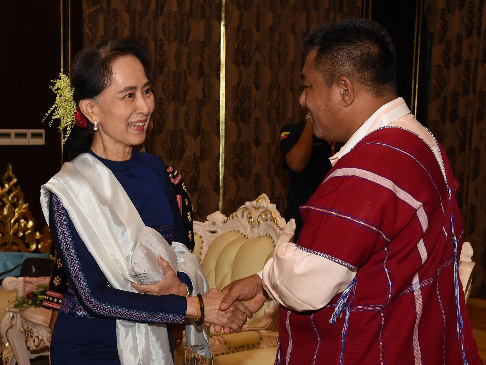 State Counsellor Daw Aung San Suu Kyi greets Chairman of DKBA Saw Moe Shay in Nay Pyi Taw.