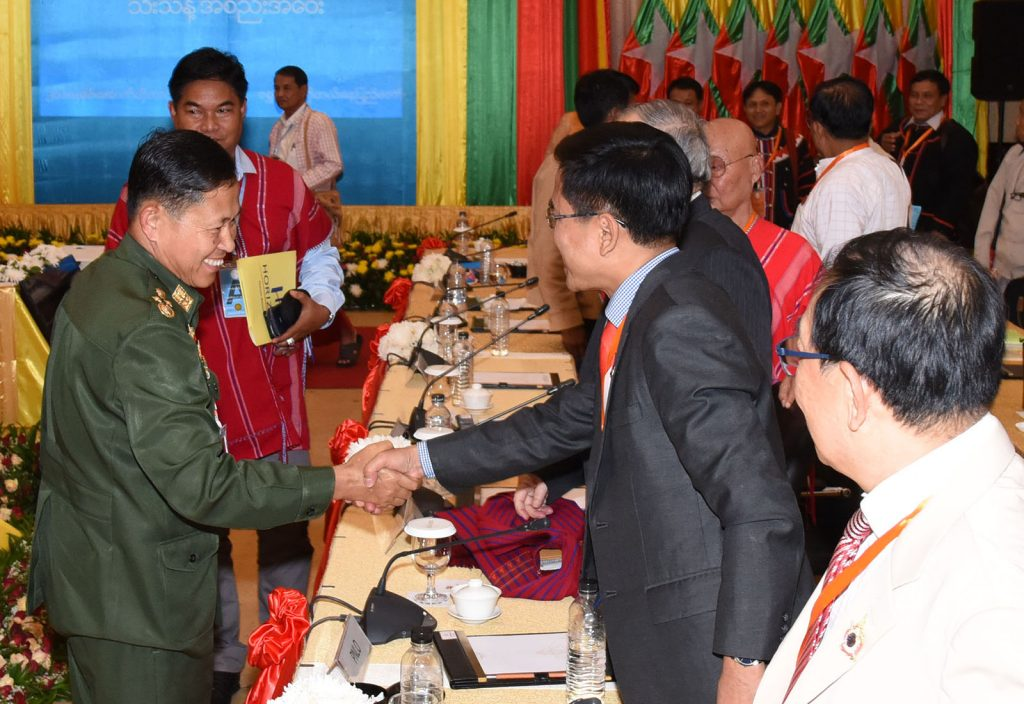 Deputy Commander-in-Chief of Defence Services Commander-in-Chief (Army) Vice-Senior General Soe Win greets Chairman of the Chin National Front Pu Zing Cung.