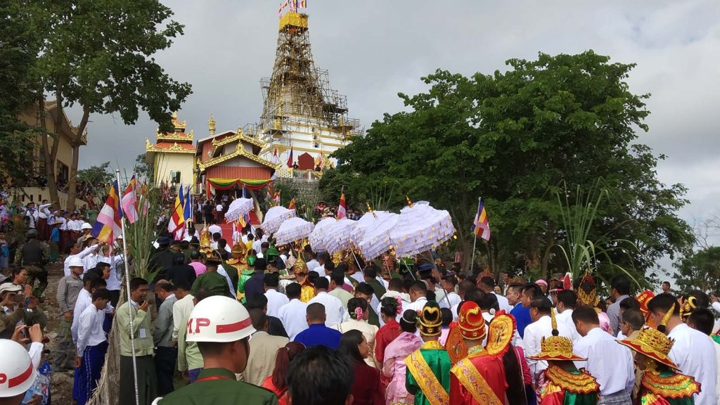 Tiers of umbrella are being carried to the pagoda.Photo: Nawnghkio IPRD