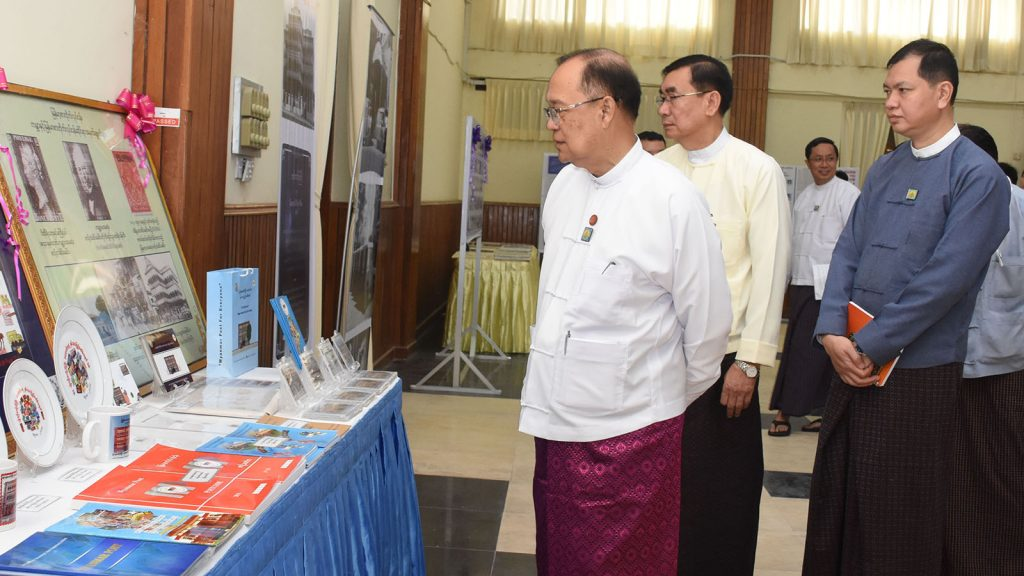 Union Minister U Thant Sin Maung views an exhibition at the World Post Day 2018 ceremony held in Nay Pyi Taw yesterday. Photo: MNA