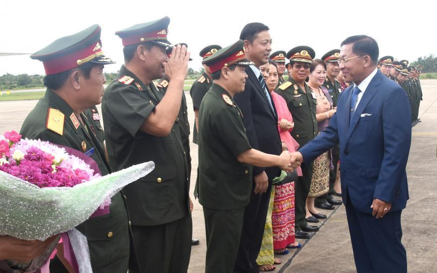 Senior General Min Aung Hlaing seen off by Lao military officers  at Pakse International Aiport in Laos yesterday.Photo: The office of the Commander-in-Chief