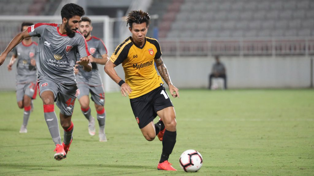 Myanmar midfielder Sithu Aug (yellow) dribbles a ball into the area of the opponents' team.photo: MFF