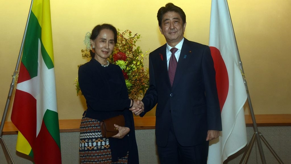 State Counsellor Daw Aung San Suu Kyi shakes hands with Japanese Prime Minister Mr. Shinzo Abe.Photo: MNA