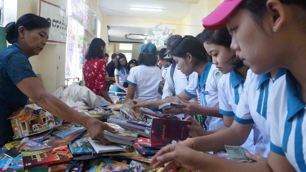 Youths choosing books at the book-stall.Photo: Nay Lin