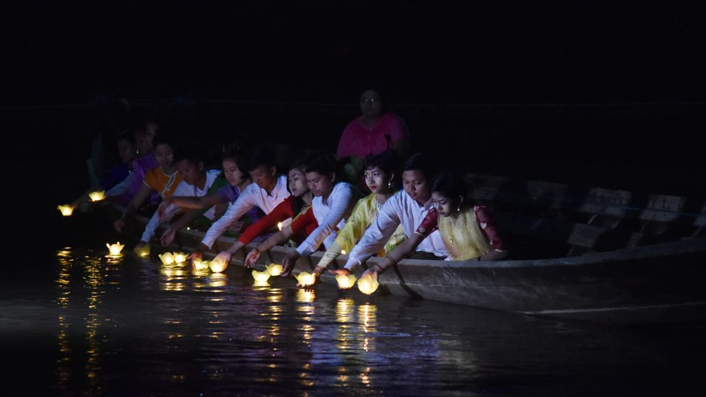 Locals release paper lanterns to float on the Shwegyin River during light festival in Shwegyin.Photo: Supplied