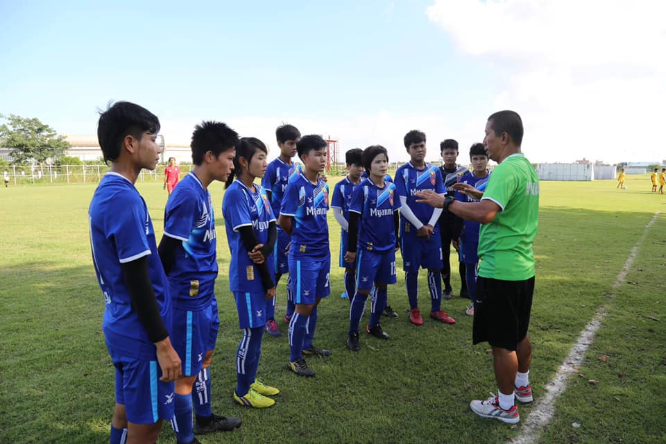 Head coach U Win Thu Moe gives instructions to Myanmar national womens players in a training session.