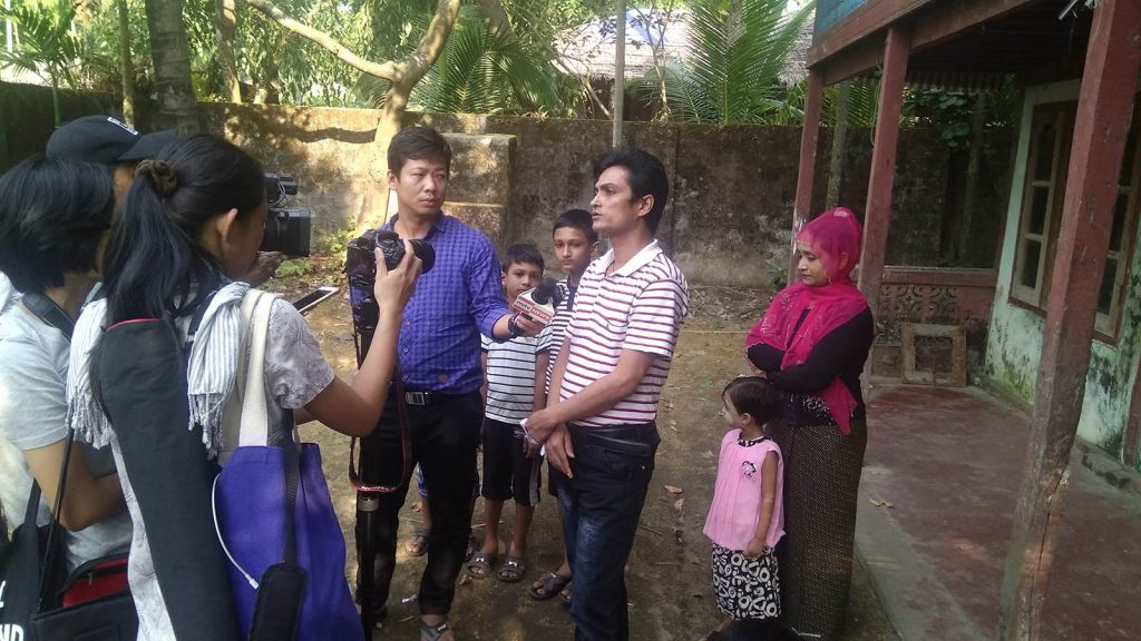 Journalists interview a family returned from Bangladesh in Maungtaw, Rakhine State, yesterday. Photo: MNA