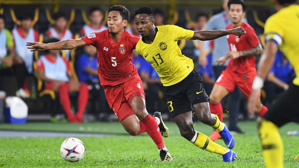 Myanmar's defender Nanda Kyaw (L) and Malaysia's midfielder Mohamadou Sumareh (#13) fight for the ball during the AFF Suzuki Cup 2018 football match between Malaysia and Myanmar at the Bukit Jalil National Stadium in Kuala yesterday.Photo:AFP
