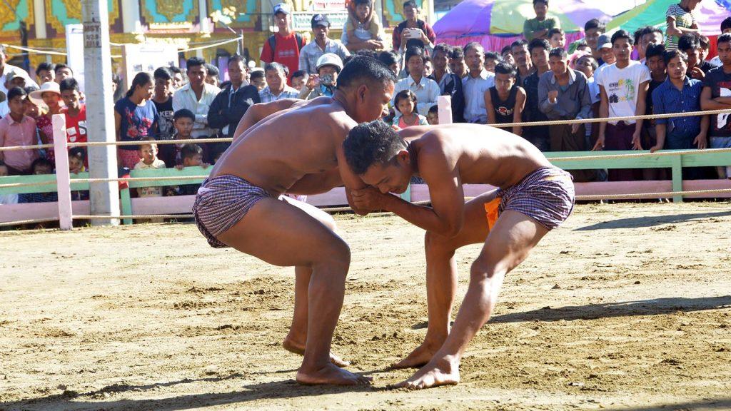 Two Rakhine men participate in traditional Kyin wrestling contest in Sittway, Rakhine State.Photo: Tin Soe