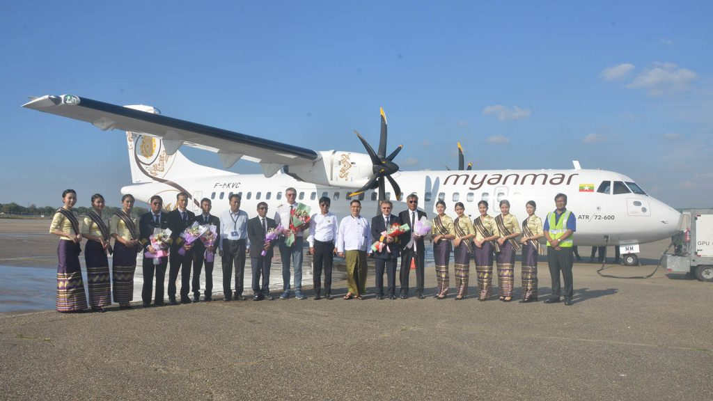 Officials, pilots and crews  Myanmar National Airlines pose for photo at the ceremony to welcome the new ATR aircraft.Photo: Aye Min Thu