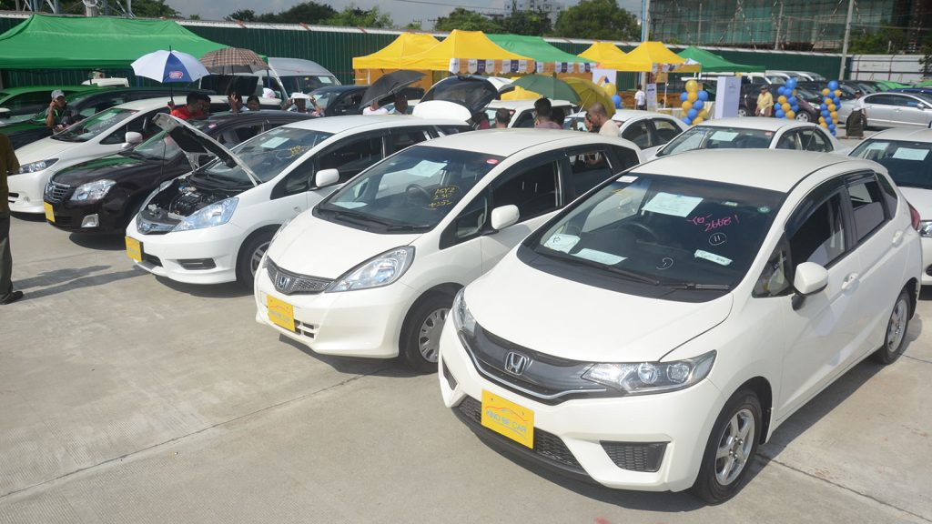 Right-hand drive cars on exhibition for sale in Yangon. Photo: Phoe Khwar