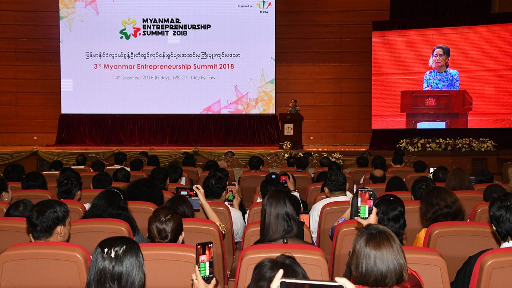State Counsellor Daw Aung San Suu Kyi addresses the 3rd Myanmar Entrepreneurship Summit – 2018 in Nay Pyi Taw yesterday.Photo: MNA