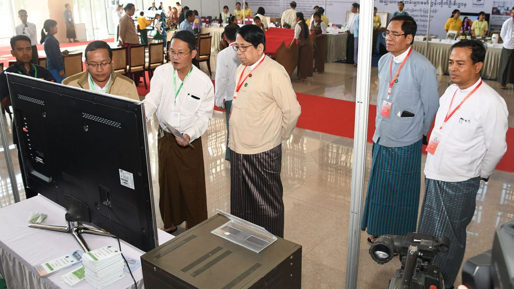 Union Minister Dr. Pe Myint and Deputy Minister U Aung Hla Tun visit a booth on the second day of 'All Who Can Read Should Read' campaign in Nay Pyi Taw yesterday.Photo: MNA