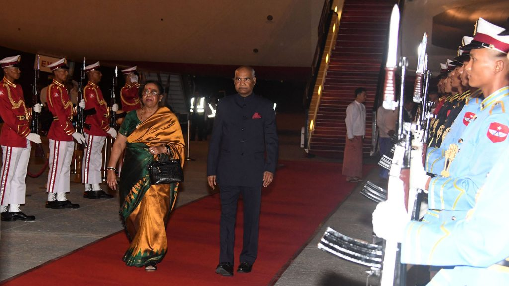President of India and wife walk past the Honour Guards as they arrive at Nay Pyi Taw International Airport yesterday. Photo: MNA