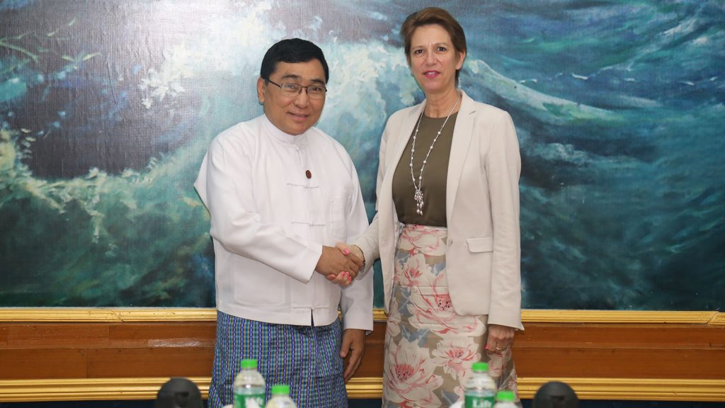 Union Minister Dr. Win Myat Aye shakes hands with UNSG Special Envoy on Myanmar Christine Schraner Burgener.  Photo: MNA
