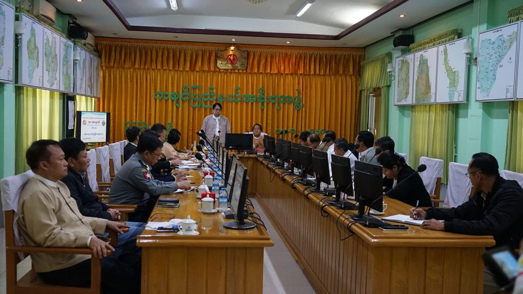 Union Minister Dr. Pe Myint addresses the coordination meeting to hold Children's Literature Festival in Kachin State.Photo: MNA