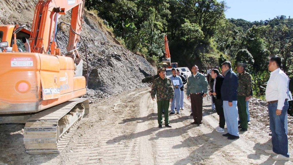 Union Minister Lt-Gen Ye Aung inspects a road section in Chin State.Photo: MNA