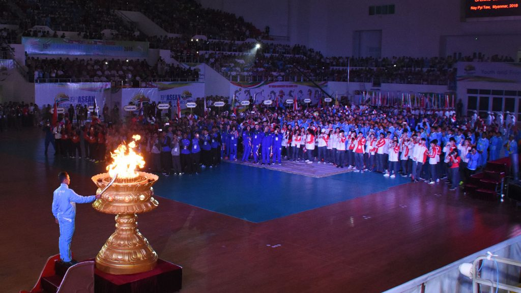 Maung Wai Lin Aung (Sepak Takraw) lights the cauldron to signify the light of spirit, knowledge and life at the 19th ASEAN University Games.photo: mna
