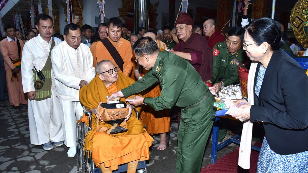 Commander-in-Chief Senior General Min Aung Hlaing donates offertories to Sayadaw Baddanta Dhamma Siri, presiding Sayadaw of Two Dragons Monastery.Photo: Office of the C-in-C of Defence Services