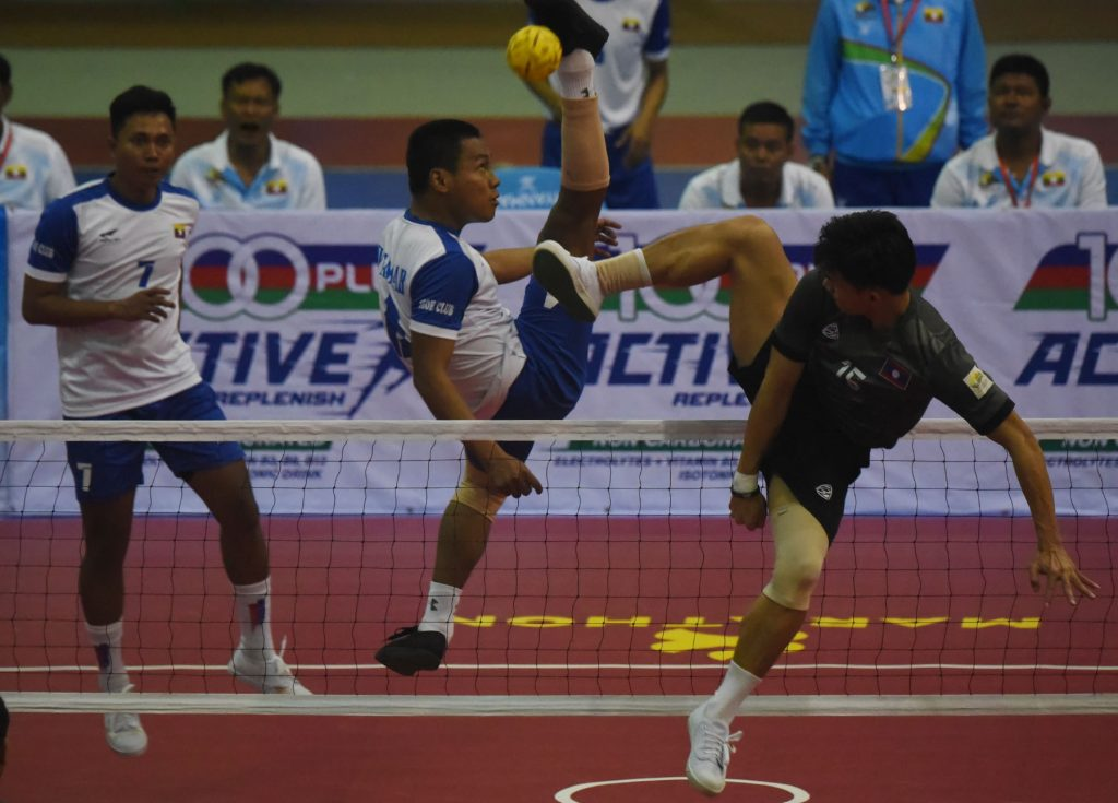 Myanmar team (white) competes with Laos team (black) in yesterday's men's double sepak takraw competition in Nay Pyi Taw.Photo: Soe Nyunt