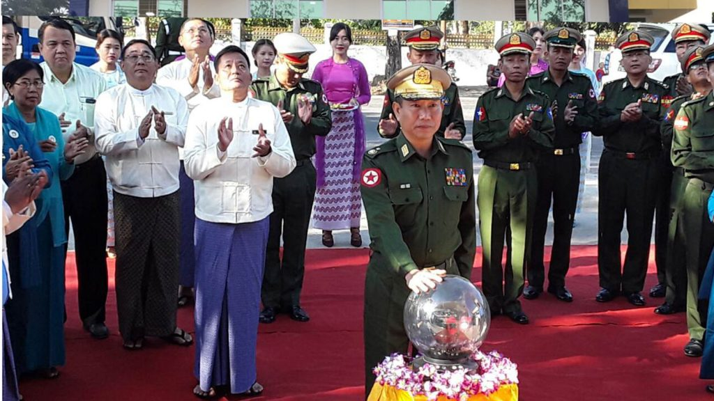 Yangon Command Commander Maj-Gen Thet Pone formally opens Innwa Bank's Hmawby branch signboard yesterday.Photo: MNA