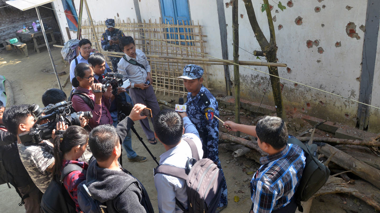 News media personnel interview the police officer at Khahtihla police outpost, one of the police outposts attacked by AA terrorist insurgents.photo: mna