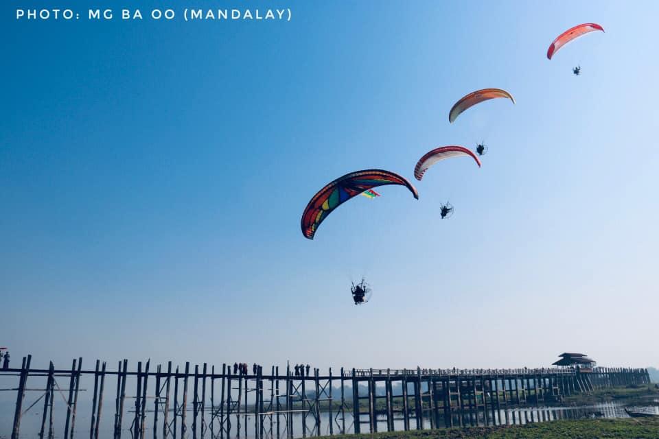 Paramotors from Myanmar and ASEAN Paramotoring Club (FLY ASEAN) give demonstration near Taungthaman Lake.Photo: Mg Ba Oo (Mandalay)