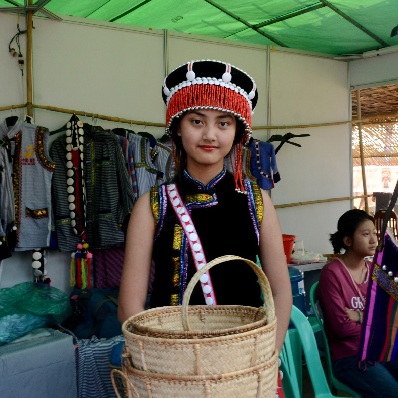 Awar Marein, a Lisu woman shows their ethnic cultural houshold goods to visitors.