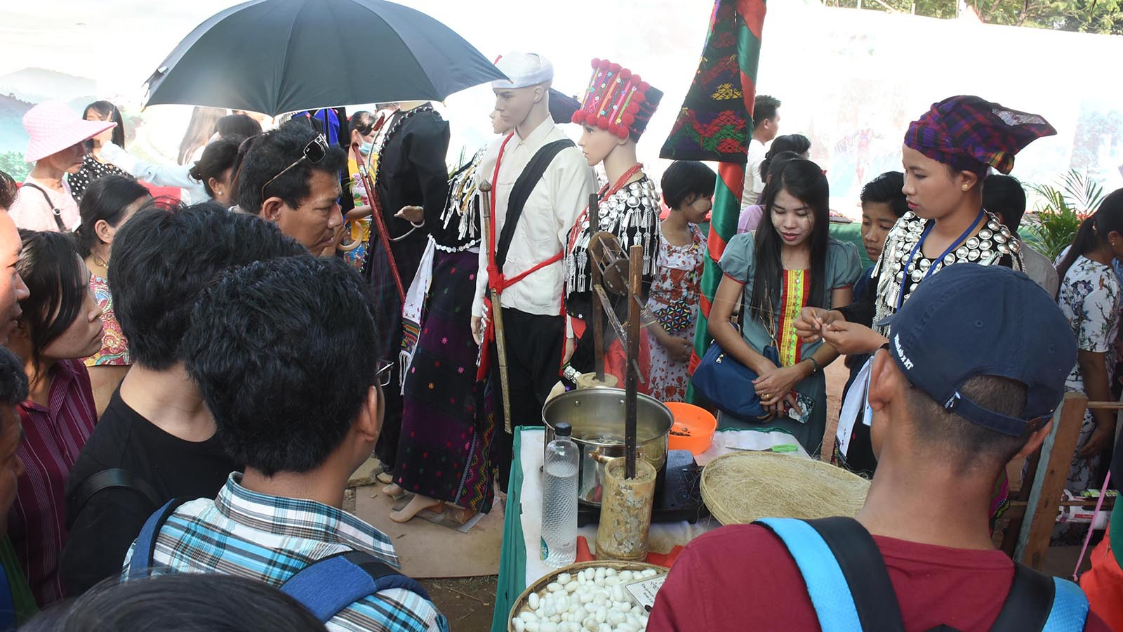 Visitors take a look around the Kachin ethnic culture exhibit at Myanmar Ethnics Culture Fest in Kyaikkasan Sports Ground in Yangon. photo: zaw min latt