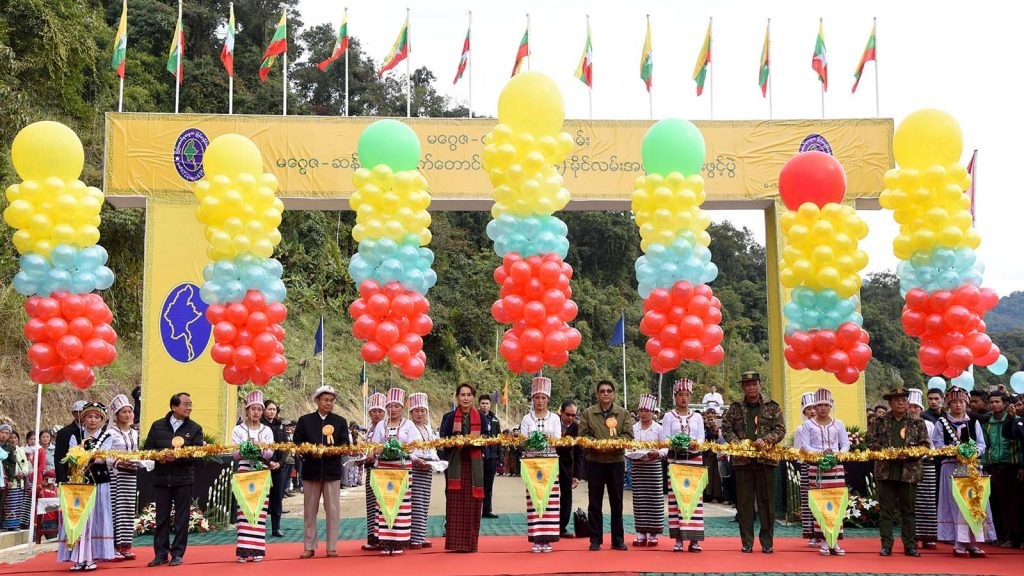 State Counsellor Daw Aung San Suu Kyi, Union ministers and Chief Minister Dr. Khet Aung cut ceremonial ribbon to open the Maggayza-Mt. Sanlutchat (33 miles 6 furlong) road section in Kachin State yesterday.Photo: MNA