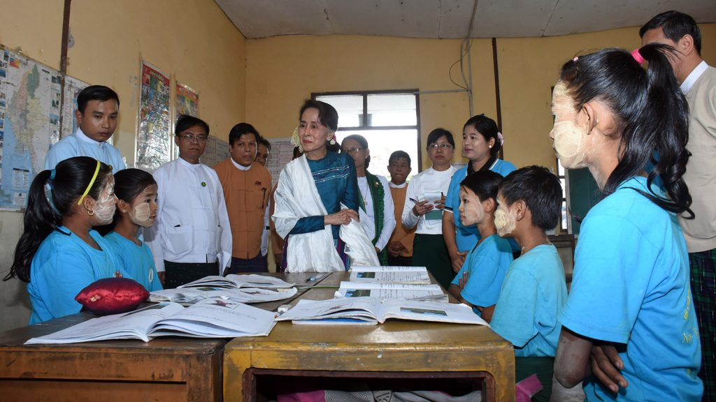 State Counsellor Daw Aung San Suu Kyi meets with school children in B.E.P.P.S (19) on Ba Htoo Street 8 in Ward 2, Hlinethaya, Yangon Region yesterday.Photo: MNA