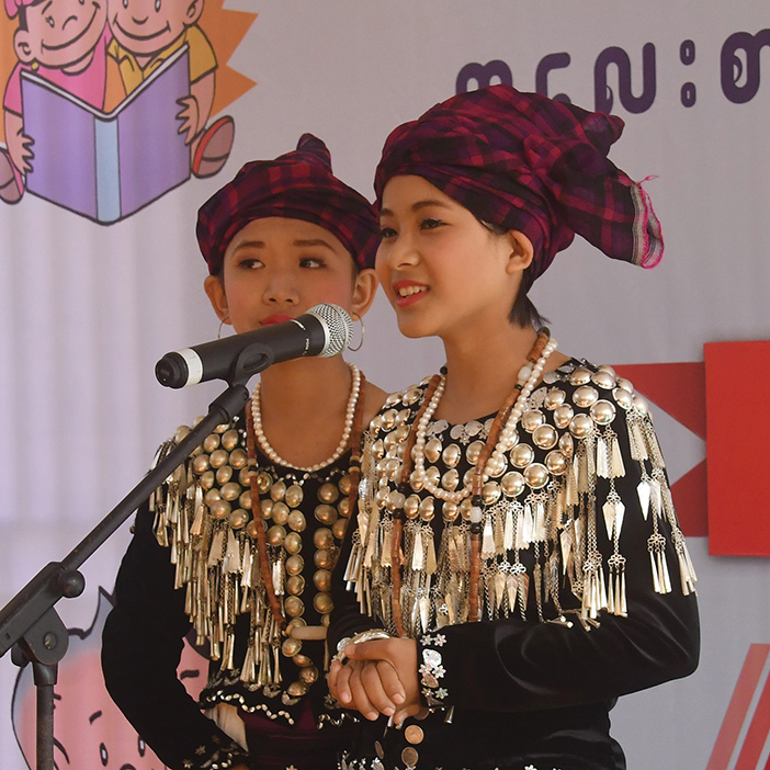 Ma Jar Dain, a Jinphaw student, competes in the storytelling contest in ethnic languages at the second day of Children's Literature Festival in Myitkyina.