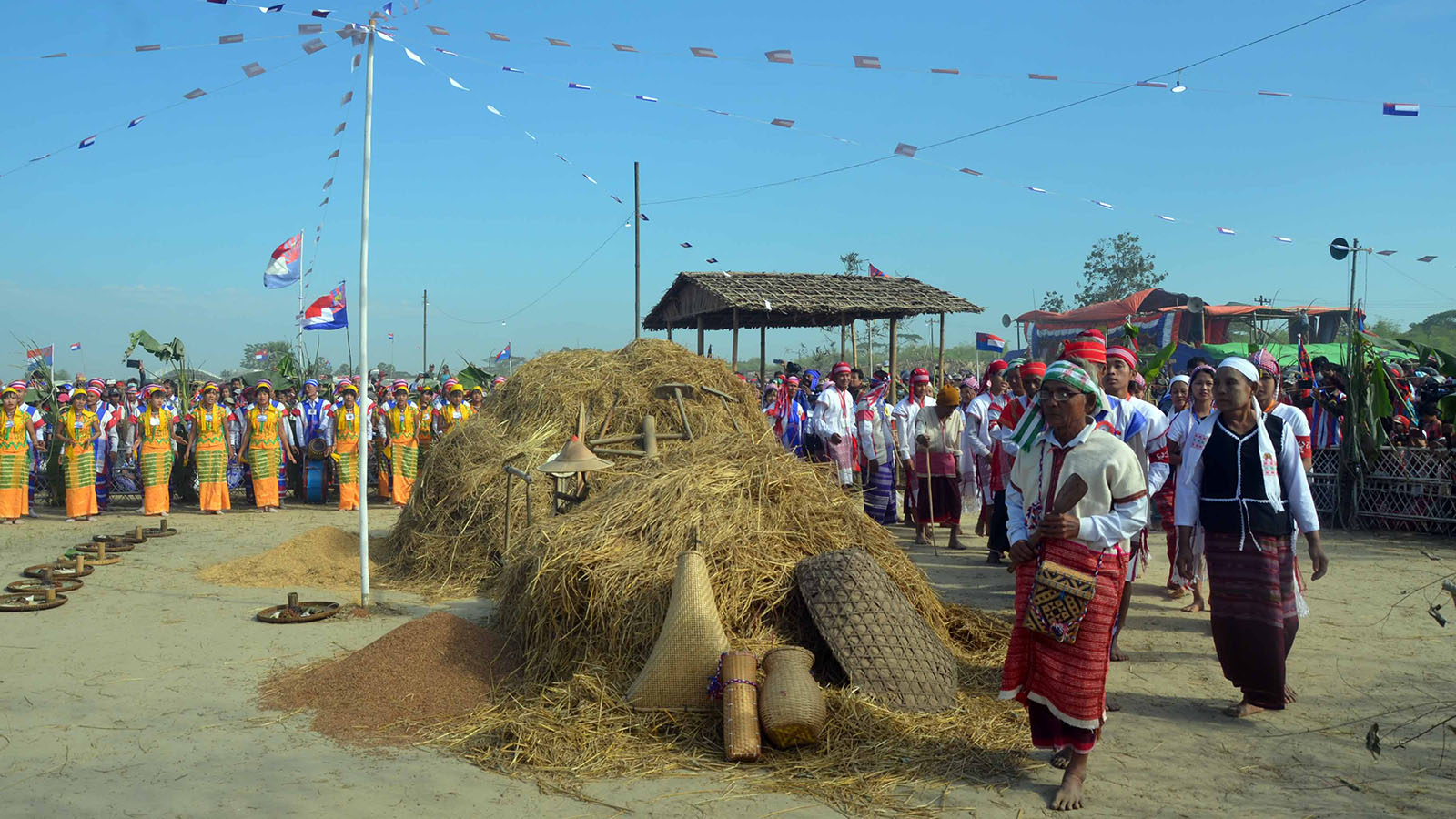 Kayin ethnic men and women participate in the Kayin New Year and harvest festival in Einme in Ayeyawady Region yesterday.