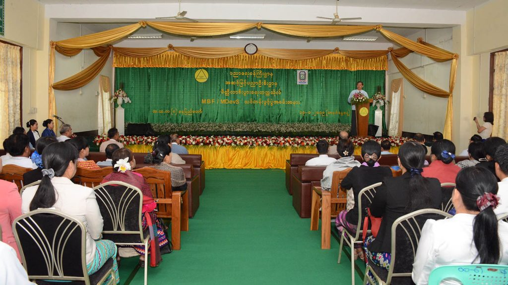 Union Minister Dr. Myo Thein Gyi addresses the opening ceremony for the Master of Banking and Finance and the Master of Development Studies courses at No.8 B.E.H.S in Nay Pyi Taw yesterday.Photo: MNA