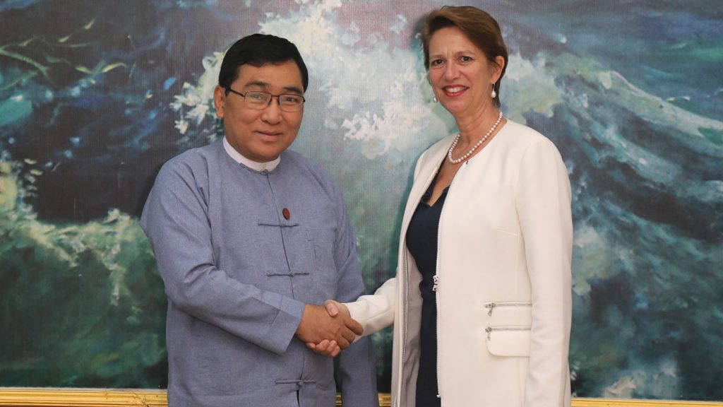 Union Minister Dr. Win Myat Aye shakes hands with Ms. Christine Schraner Burgener, Special Envoy of UN Secretary-General to Myanmar. photo: mna