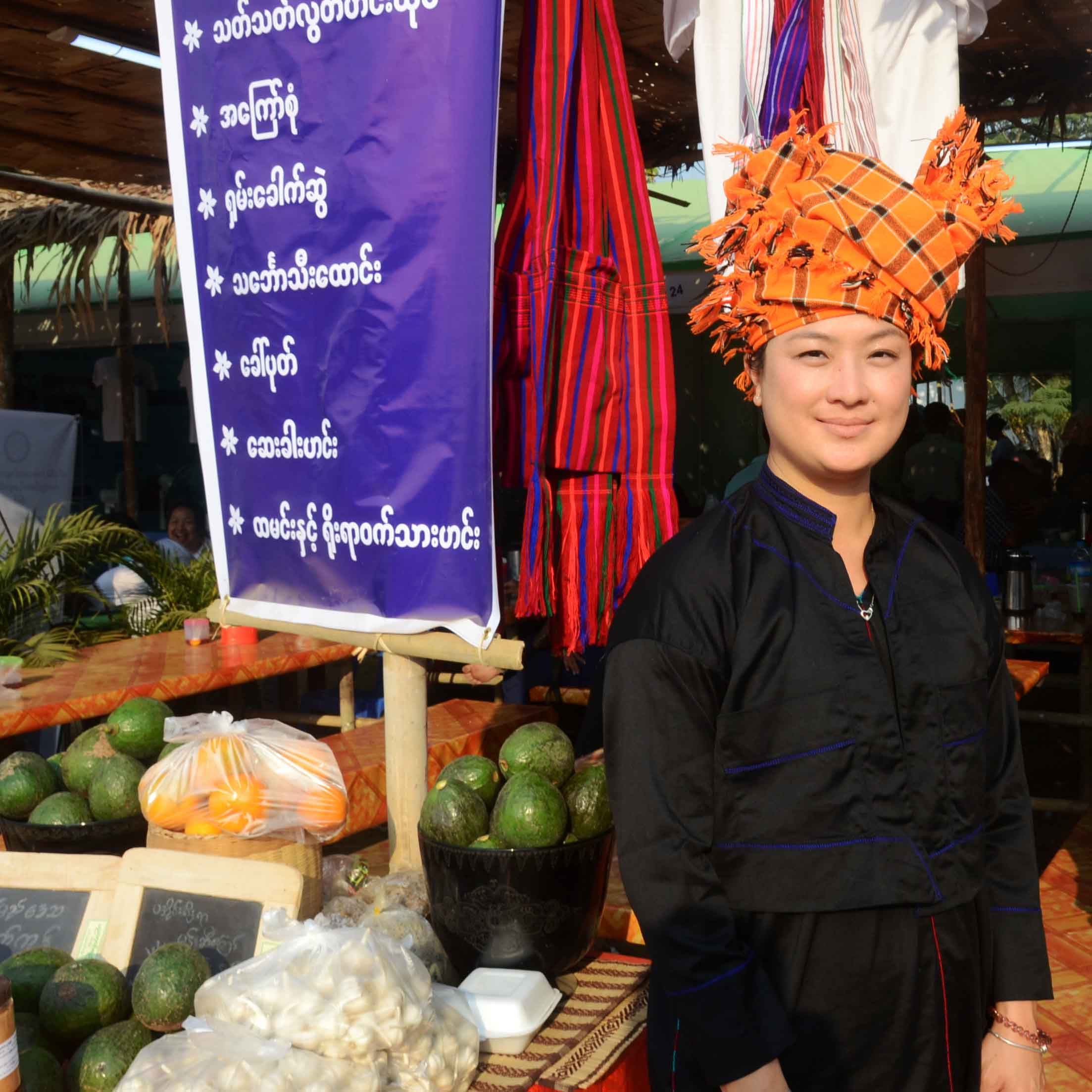 Ma Naw Naw, a Pa-O woman, waits customers as she sells Avocado fruits from her native town in Shan State.