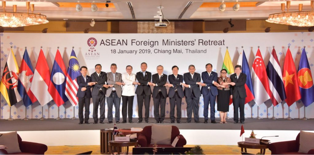 Union Minister for International Cooperation U Kyaw Tin (Second from Left) poses for photo in ASEAN way with foreign ministers of ASEAN countries at the ASEAN Foreign Ministers' Retreat in Chiang Mai, Thailand. Photo: MNA