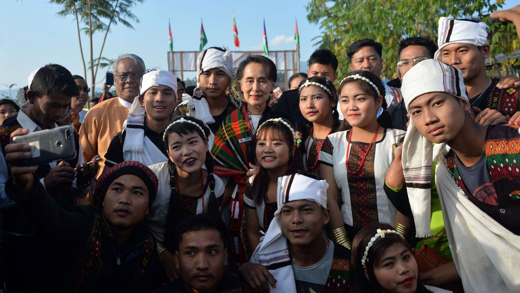 State Counsellor Daw Aung San Suu Kyi poses for the documentary photo together with ethnic people from Haka Lay South Village and North Village. PHOTO: THET AUNG