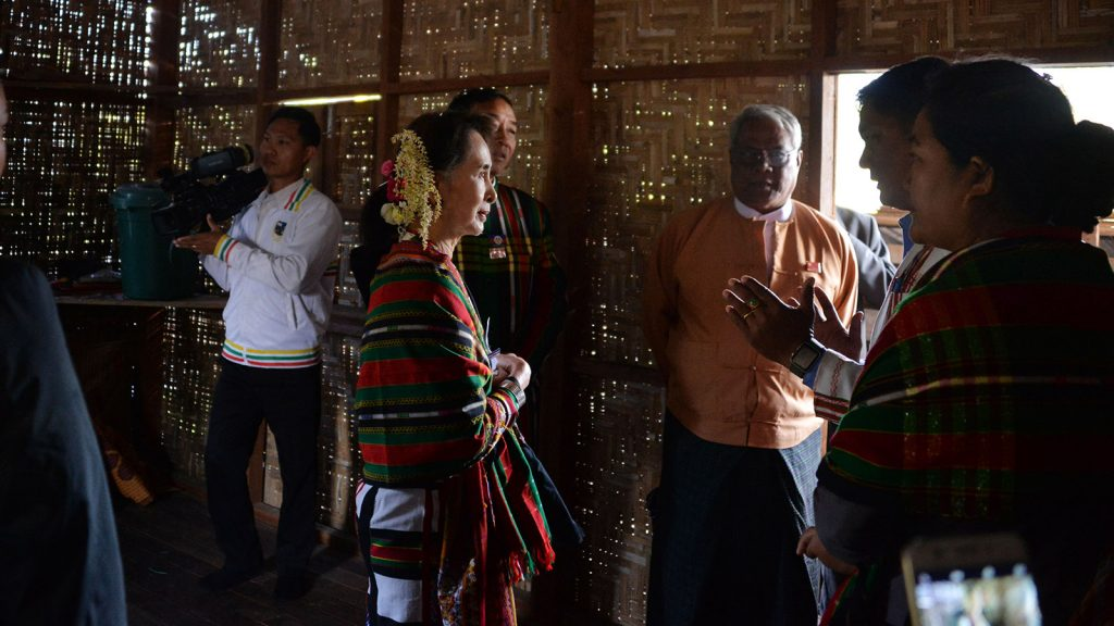 State Counsellor Daw Aung San Suu Kyi inspects a house built by Daw Khin Kyi Foundation in Haka Lay South Village yesterday. Photo: MNA