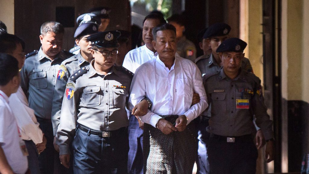 Kyi Lin, (2nd-R) the suspected gun man who shot and killed U Ko Ni, a legal advisor to National League for Democracy, is escorted by police on arrival to face the court verdict in Yangon on February 15, 2019. Photo: AFP