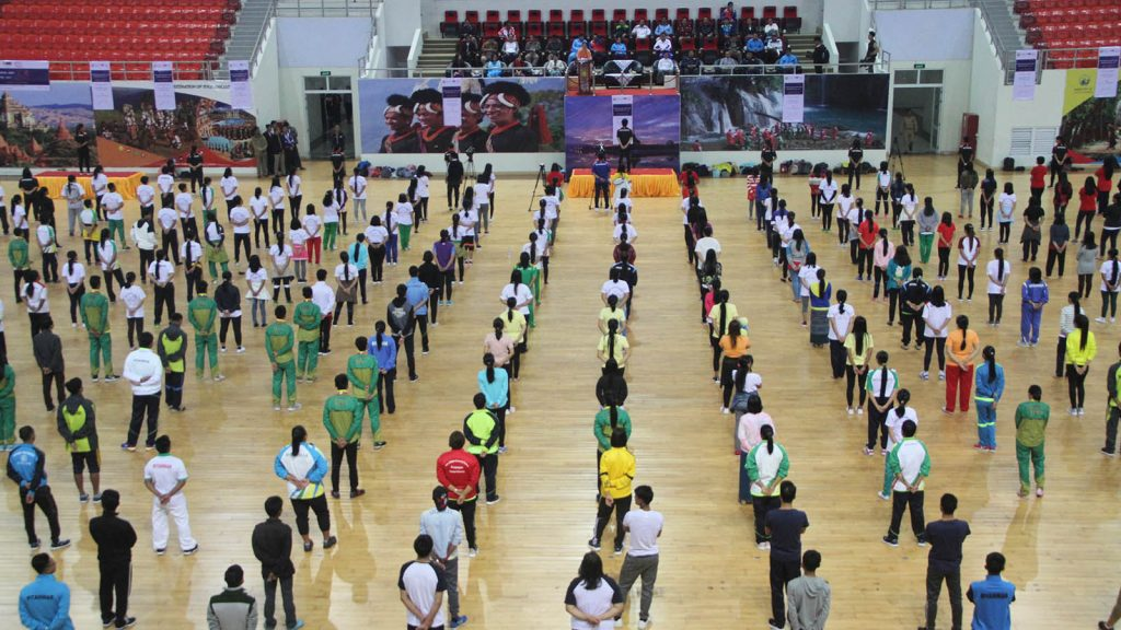 Staff from the Department of Sport and Physical Education and the Ministry of Health and Sports listen to a speech on cancer awareness before engaging in a collective physical fitness dance, at a ceremony to mark World Cancer Day held in Nay Pyi Taw. photo: mna