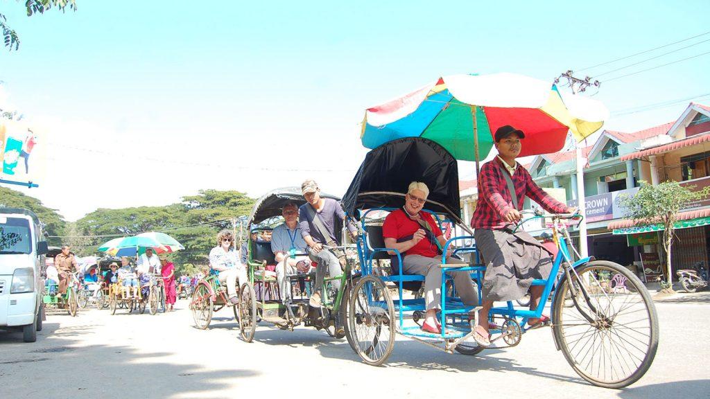 Tourists enjoy riding trishaws to tour Katha, Sagaing Region.Photo: Ngwe Oe (Katha)