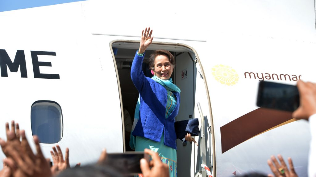State Counsellor Daw Aung San Suu Kyi waves atop the steps of the Myanmar Airways before departing to Nay Pyi Taw yesterday.Photo: Thet Aung
