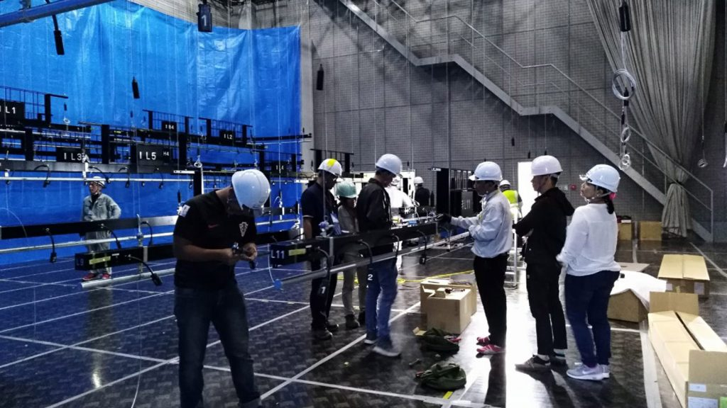 Workers install broadcasting equipment at the MRTV.